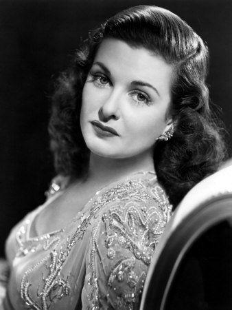 Joan Bennett looking elegant in a jewel-encrusted gown...