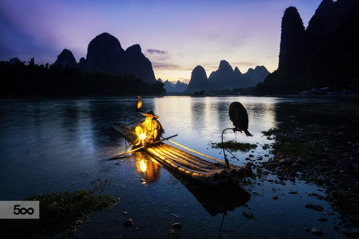 Ethereal Night by Aaron Choi _ The old man on the famous li river in xingping.