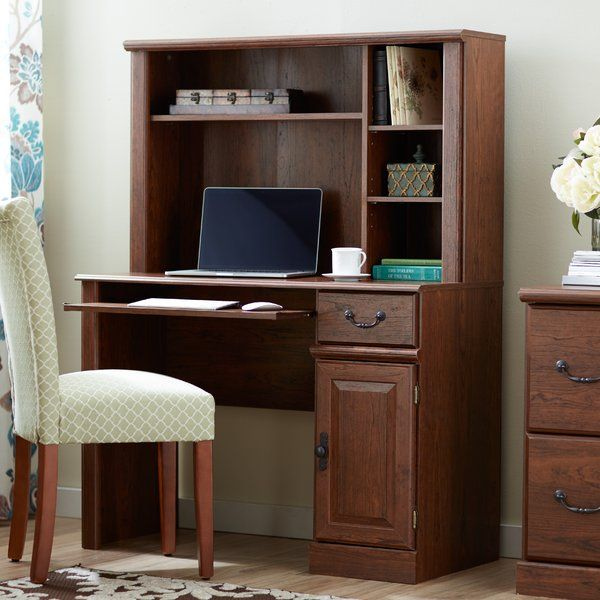 Add classic appeal to your office with this wood computer desk. The attaching hutch features built in shelves, perfect for stowing supplies, while the slide-out keyboard shelf makes this piece the perfect home for your computer.