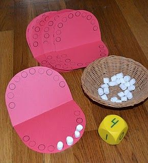 Great for tots - preschoolers to begin to learn about numbers and teeth! =) I would have older kids roll twice and put the number of marshmallows for top and then the bottom and then they can count the total. Great beginning addition.