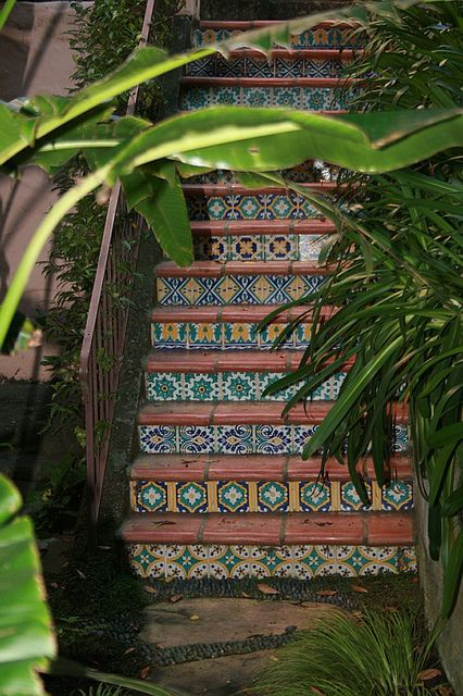 Stair detail with saltillo paver treads and Spanish tile
