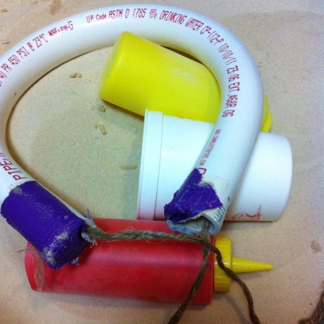 DIY gymnastics rings - sand filled PVC in a 350• oven for 10 minutes. Wrap around paint can.