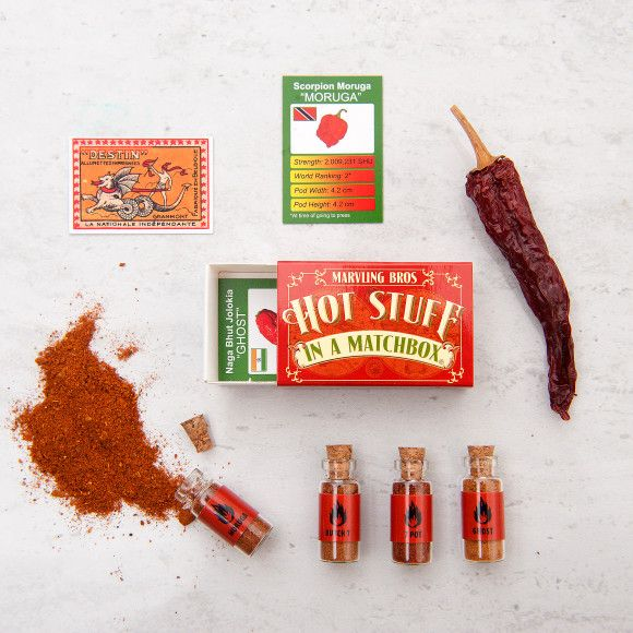 Something so strong in something so small...  This explosive box contains some of the hottest chilli powders ever tested, including world champion Scorpion Moruga (2,000,000 SHU), a former world hottest Butch T (1,500,000 SHU), the legendary 7 Pot (1,300,000 SHU) , and the ten minute burner Ghost powder (1,000,000 SHU). Each one is beautifully presented in a corked glass bottle.  The box also includes four fun chilli fact cards and a limited edition super hot collector's card. This all comes…