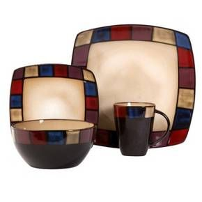 The Gibson Soho Lounge 16 piece Dinnerware Set is a glazed stoneware dinnerware set with service for four. The set includes dinner plates, salad plates, bowls and mugs, each in a coordinating design inspired by traditional stained glass. The glaze and color are a beautiful visual experience, but the pattern is simple enough for versatile plating, and has a contemporary feel.