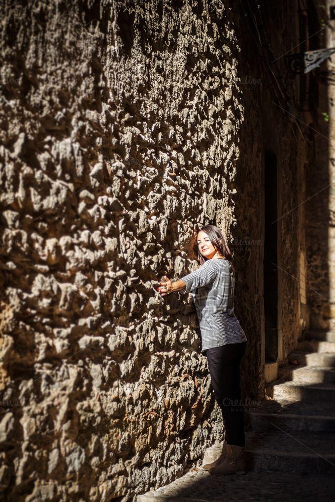 Woman on wall by OSORIOartist on Creative Market