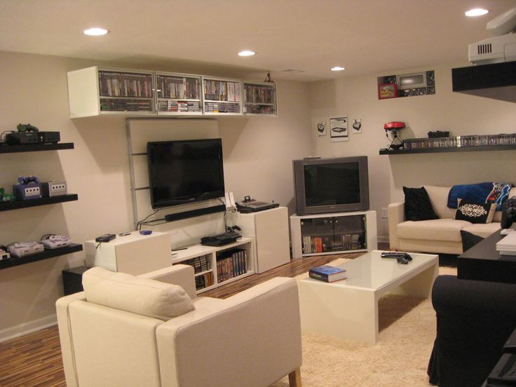 Very clean gaming room with a lot of systems and consoles - via Backward Compatible Video Game Blog