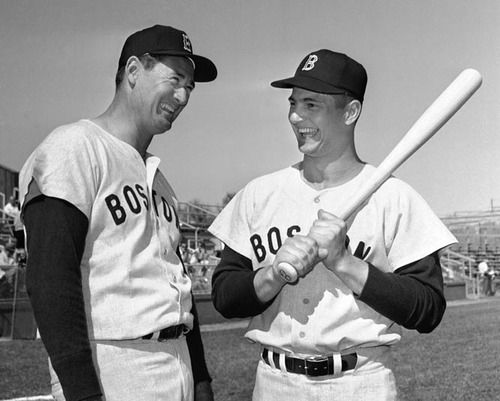 Carl Yastrzemski and Ted Williams pose together before a 1963 Red Sox game. (AP)