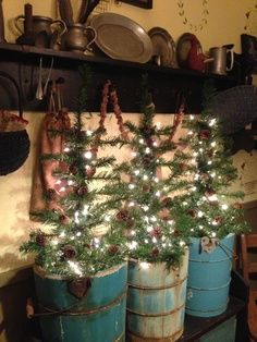 Primitive Christmas Decorating Ideas | Prim Christmas Trees...in old blue buckets.