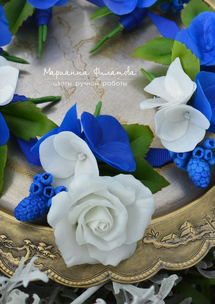 handmade flowers . cold porcelain. boutonniere