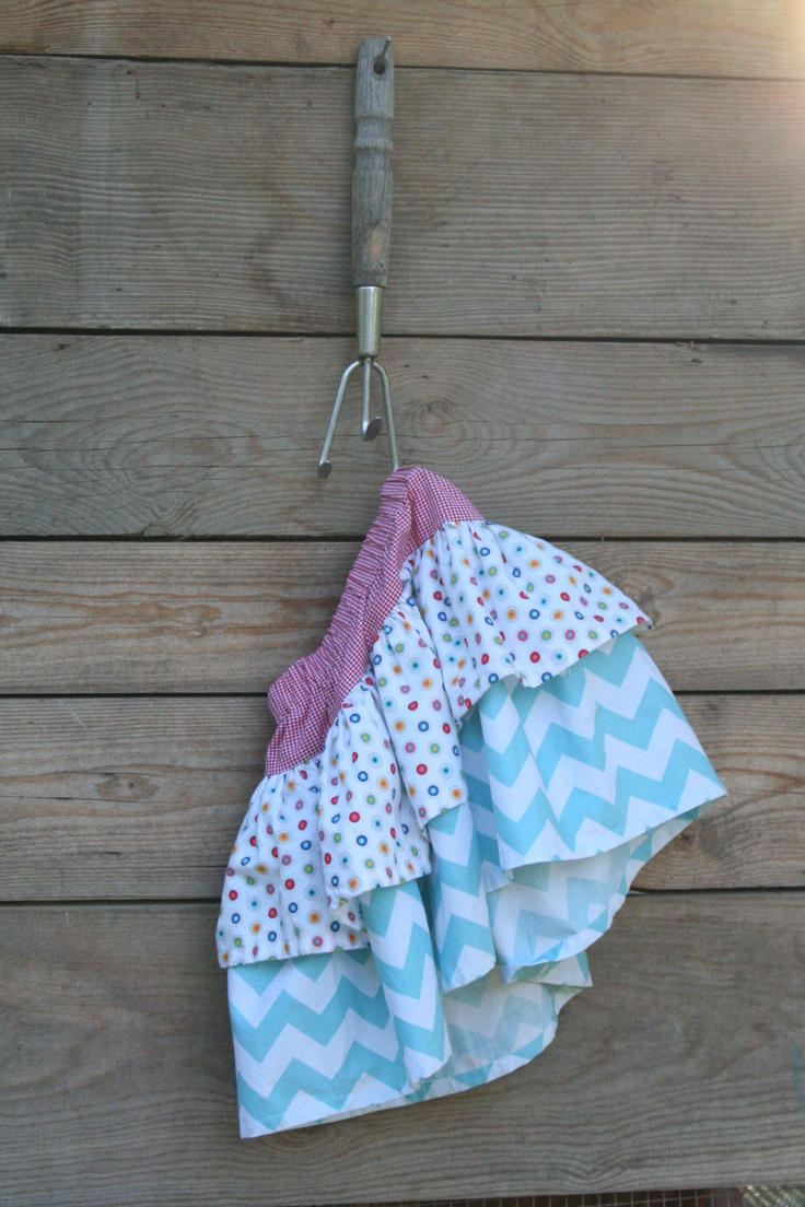 """FOR SIZE 5:  top casing piece - 5""""x28"""";  dot layer - 2 of 7""""x 37"""";  chevron layer - 2 of 12""""x 37""""  >> Seam short ends of casing piece. Fold, press, stitch 1 edge for casing  >> Seam short ends of layer pieces  >> Hem one long edge of each layer  >> Place short layer on top of longer layer with upper (raw) edges even. Gather.  >> Attach to lower edge of casing piece  >> Insert elastic into casing.  CUTE!!"""
