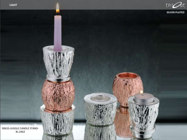 Silver-Juggle Candle Stand. Call- 9830554561.
