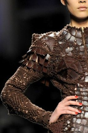 Sleeve detail of Jean-Paul Gaultier crocodile skin/crochet dress