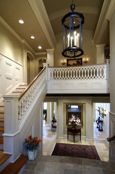 """open basement."" What an amazing idea -- instead of hiding your basement make it a reverse foyer. Stunning. - love the railing!!"