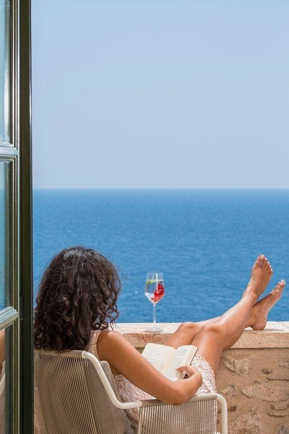 A book, wine and the blue sea, it works for me!
