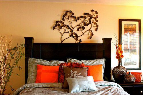 Guest bedroom... black frame grey bedset orange throw pillows