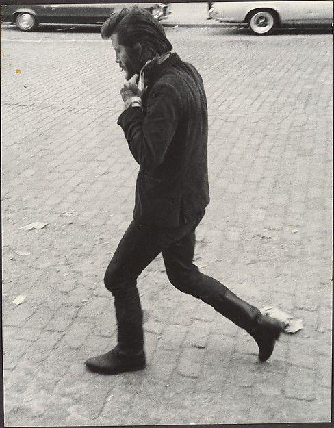 [Street Scene: Man in Boots Walking and Adjusting His Collar, New York City] Leon Levinstein (American, Buckhannon, West Virginia 1910–1988 New York) 1960s - 70s