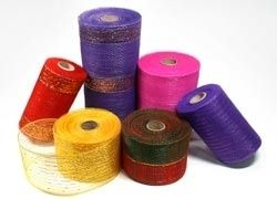 http://www.fuzzyfabric.com/floral-mesh/ -  Deco poly mesh, floral mesh wrap wholesale in various sizes with 50+ colors. Best  used to wrap flowers, these floral poly deco mesh ribbon, wreath will sparkle your special occasion. Order high quality poly ribbon, jute mesh, cotton mesh at cheap, discounted, wholesale rates. http://www.fuzzyfabric.com/floral-mesh/