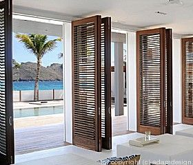 Image 7 for BEACH HOUSE INTERIOR - Inswing louvered door panels.