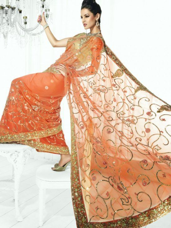 綺麗な装飾がモダンなサリー。インドサリーの着方