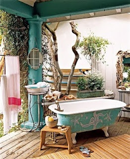 Aqua bathroom. I would love to have a bathtub like this someday, partially outside