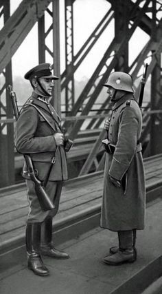 A Polish and German border guard on a rail bridge near Bohumín, which was annexed by Poland from Czechoslovakia after the completion of the Munich Agreement . October 1938