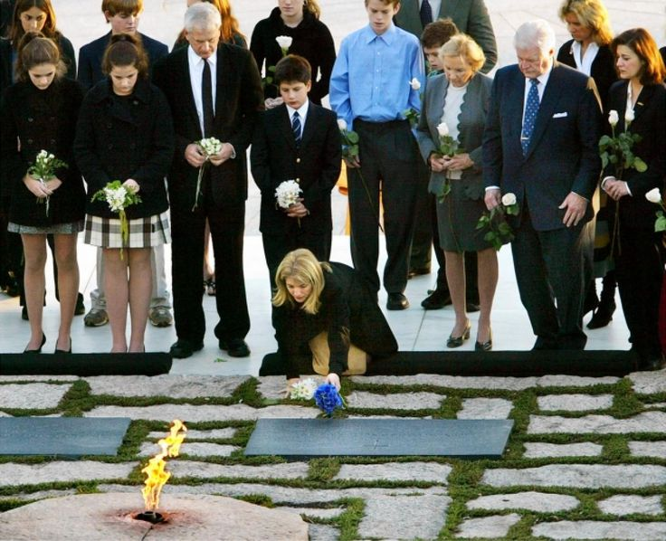 Caroline Kennedy Schlossberg kneels to place flowers on his grave in Arlington National Cemetery in Arlington, Va., on the 40th anniversary of his death. Behind her in front row are, from right, Victoria Kennedy, the wife of Sen. Edward Kennedy, JFK's brother Sen. Edward Kennedy, D-Mass., Ethel Kennedy, Robert Kennedy's widow, Caroline's son John Schlossberg, her husband Edwin Schlossberg, and daughters Tatiana and Rose Schlossberg.