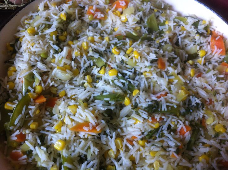 Basmati rice with vegetales: Sauteed onion, carrot, bok choy, corn with vegetable stock!