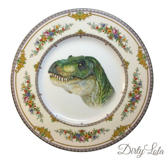 This is a unique beautiful vintage plate, featuring T-Rex looking as dashing as can be, surrounded with a halo of flowers and decorative filagree.  Would look great hanging on your wall or displayed in your china cabinet. This is a large sized side plate measuring approx 10 inches in circumference .  My plates are for decorative purposes only, the transfers are long lasting and high quality, but are not food safe- so please take note of this.  Due to the vintage nature of the plate, there…