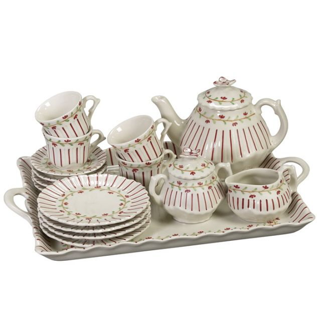 Ivory tea set with red pin stripes on an ivory background  $64.99