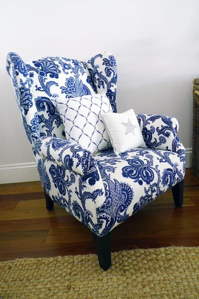 Wing chair upholstered in a blue and white Jacobean print fabric. I love the…