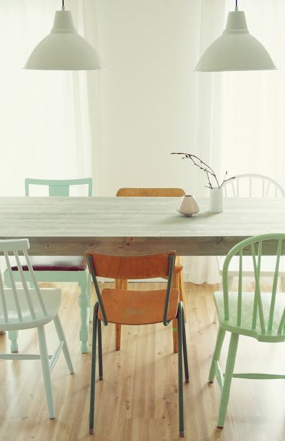 Mix and match of neutral and pastel colours and old school chairs
