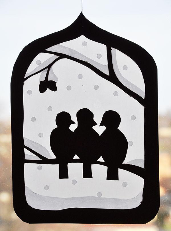 fensterbild winter drei spatzen  einem haselnussstrauch