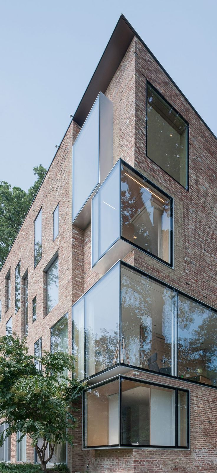 While renovating the detached Rock Creek House property, the architects removed ornamentation from the brick facades and extended the walls upward to create a larger attic space.