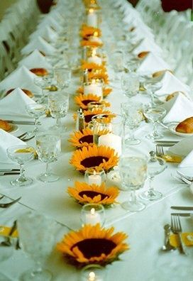 AMAZING idea for long tables at your wedding reception - sun flowers or other large flowers and candles alternating