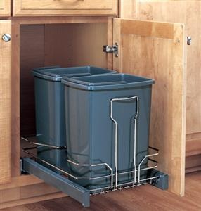 A cabinet pullout like this one keeps the kitchen trash away from kids and pets. Good idea for recycling, too. Made by Rev-a-Shelf.