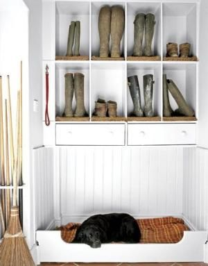 A mudroom with a built-in dog bed. Love the leash hook there too! Great idea to keep everything your pet needs in one space instead of scattered all over the house.  want tile floors, and a place to put dog crates, dog food, and dog bed...also want a doggy door to the outside from mudroom. by Judd Watts