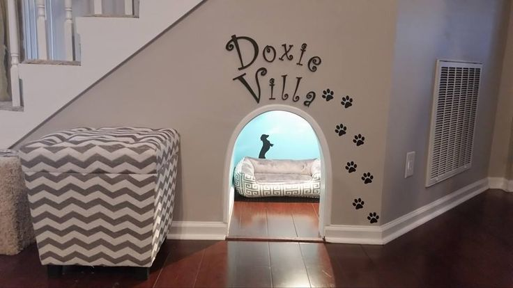 Adorable under the stairs little doggy room!