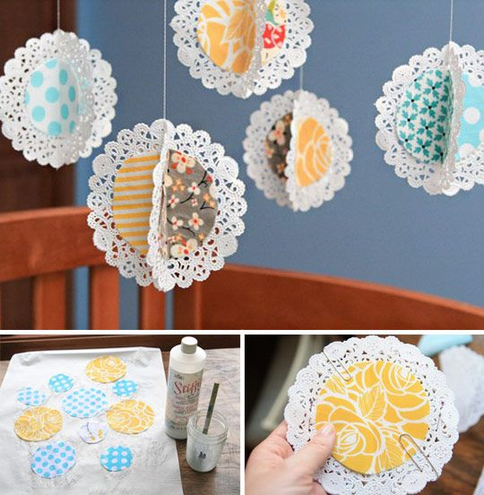 Make A Doily Mobile with doilies and scrapbook paper. This could easily be turned into holiday decor with holiday scrapbook paper.