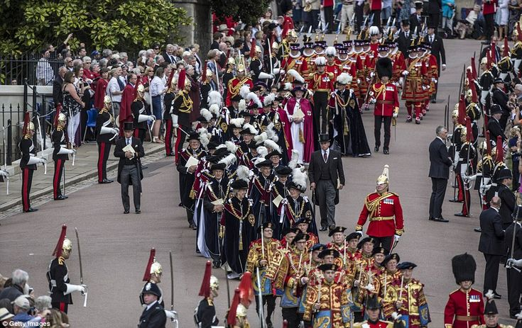 On their way: The members of the Order of the Garter, pictured in their livery, process in...