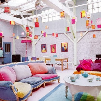 """This room is an example of a Triadic color scheme. The red, blue, and yellow colors have a low intensity that give the room a """"laid-back"""" feeling. The red is the 60%, The blue is used in about 30%, and the yellow serves as a accent, used in about 10%, of the colors."""