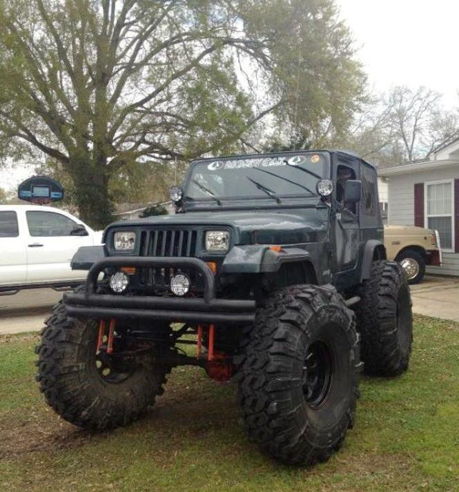 Lifted Black Jeep With Big Tires