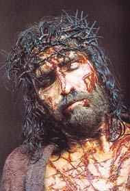Passion of the Christ Pictures, Jesus Pictures He really did look this bad before he was crucified according to medical accounts of the time about flogging and he got the maximum.  The Bible tells us that he was beaten before that and the crown of long strong thorns was pressed into his head. There are also medical accounts of crucifixion.  It was horrific and gruesome ! He went thru it for us.