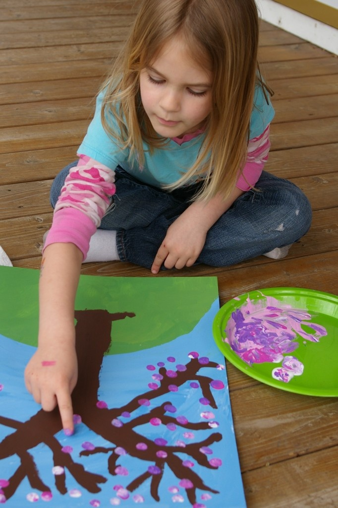 spring art project...finger tips to create flower buds(two to make hearts) on the tree. I would love to do these on canvas next year one for each season