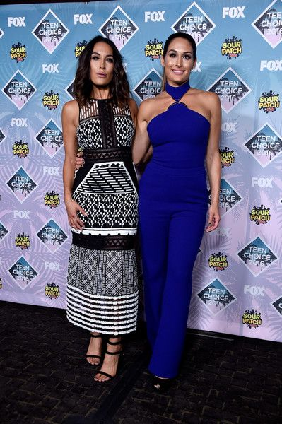 Nikki Bella Photos - WWE Divas Brie Bella (L) and Nikki Bella pose in the press room during Teen Choice Awards 2016 at The Forum on July…