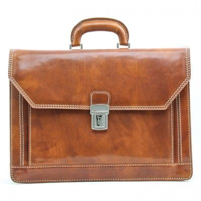 The Capri Flap Over Briefcase is laptop compatible, It will hold files, a newspaper, notebooks etc, the top swings open for easy access to all of your files and belongings. This Italian Leather briefcase is a triple compartment case that has an additional outside pocket offering a lot of space and versatility..