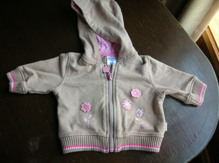 "Size ""0000"" (Newborn) Zip up hooded jacket To wear when outside or in cold weather-can be worn over wonder suit. Zip means you can adjust temperature and attached hood keeps baby's head warm and can't fall off and get lost.  Zip is also good, because you don't have to squeeze anything over baby's head."