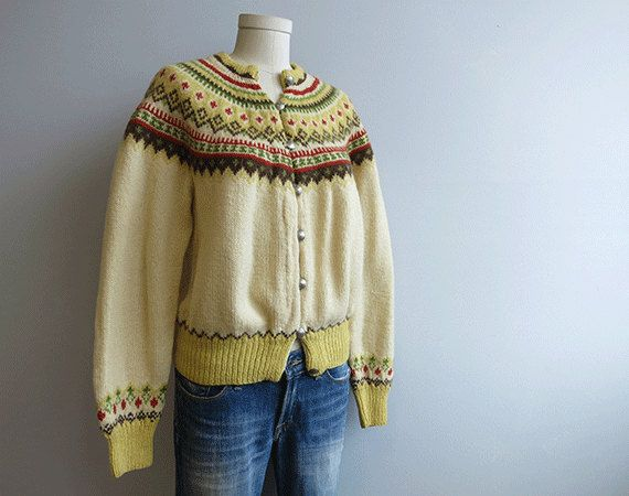 You dont simply buy a hand knit nordic cardigan...you marry it. Well cared for a sweater like this will last a lifetime. This lovely handknit wool cardigan is done up in a warm fall palette of cream, golden yellow, chocolate brown, bright olive green and terra cotta. Rounded fair isle