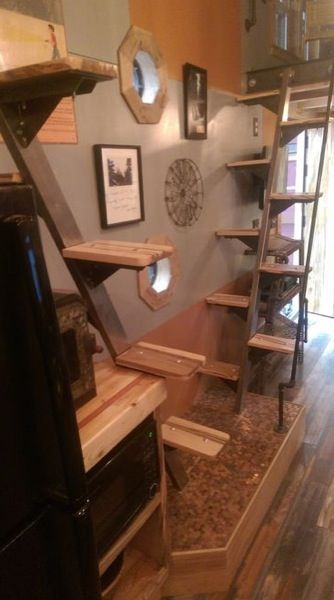This340 sq. ft. Steampunk Adventure House is ready for full time living. It's designedwith a rustic and industrial feel. Love the stair ladders. | Tiny Homes