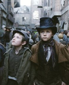 Puck and the Artful Dodger. I really like this artful dodger costume. Nice design; dark and muted colors. Nothing ostentatious or calculated to draw attention to it. Simple.