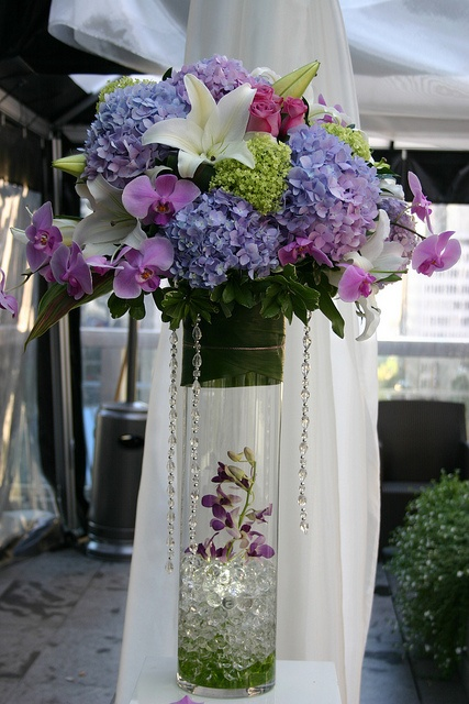 blue & green hydrangeas, pink phaelonopsis, white lilies